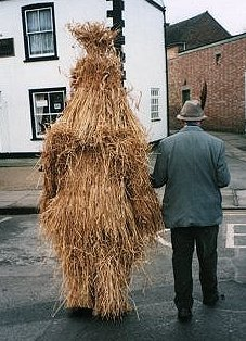 The Whittlesea Straw Bear with his keeper (looks like they are going to the pub!!)