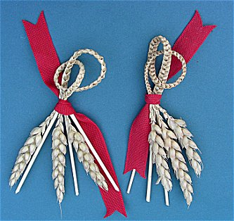 two favours made with three straw plaits